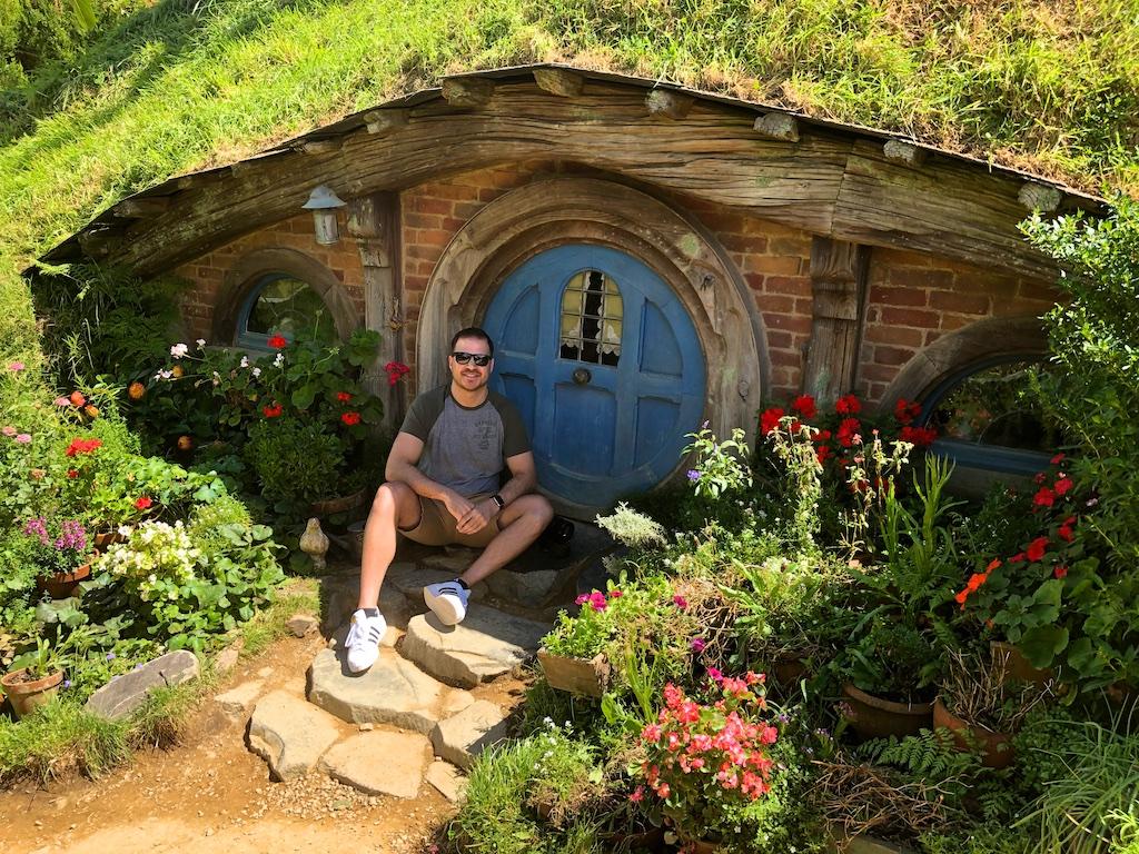 Man at hobbit hole Hobbiton Movie Set Tour