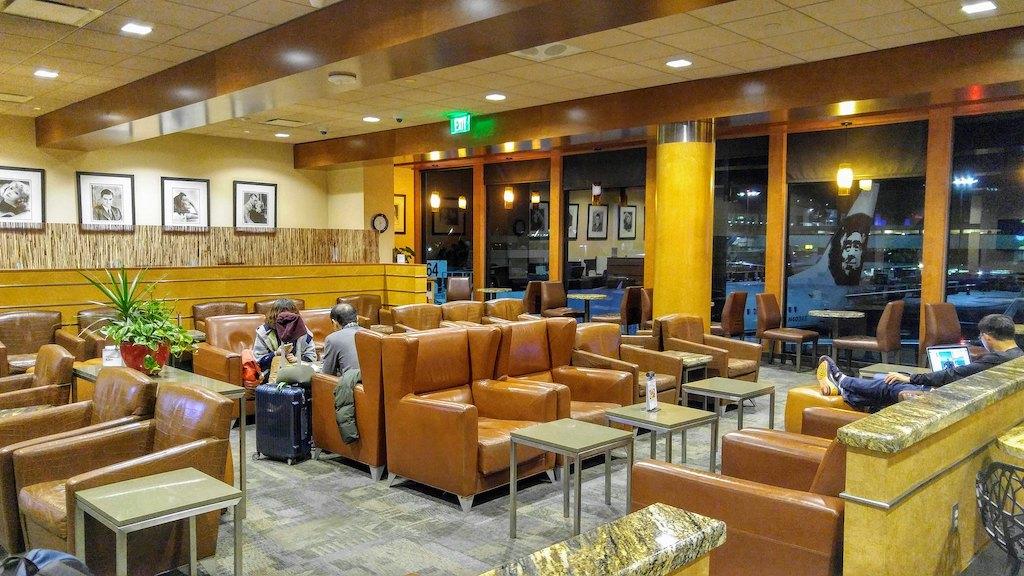 Alaska lounge seating area with views of tarmac