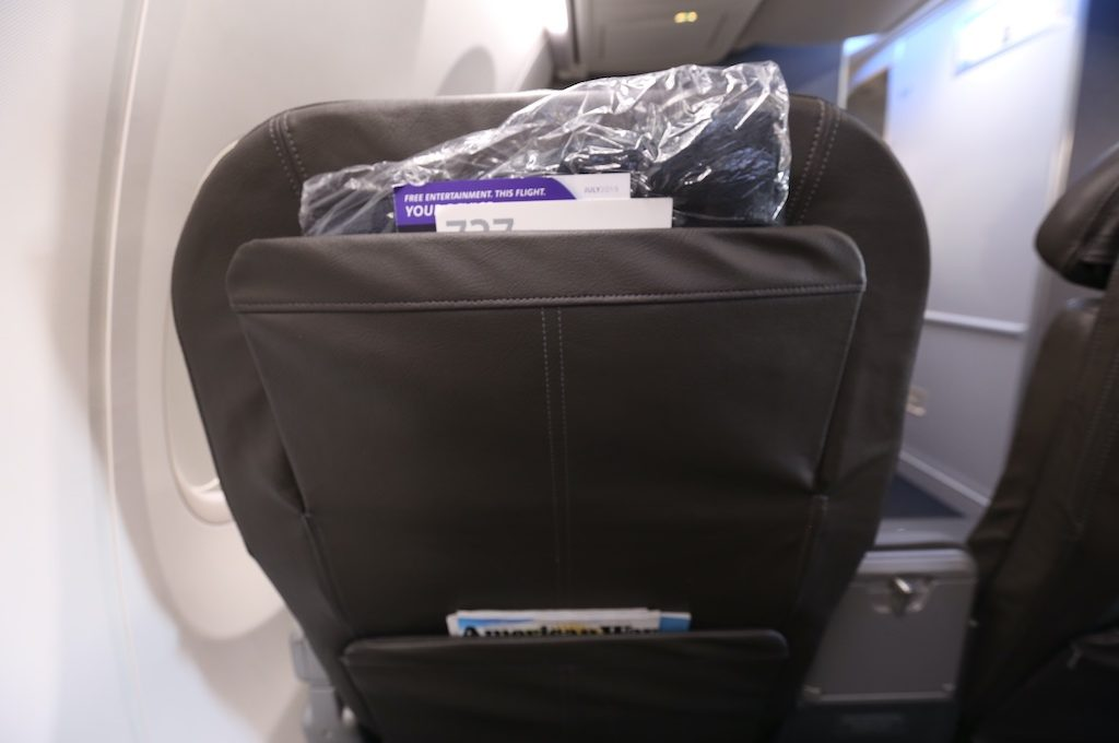 Back of American Airlines first class seat.
