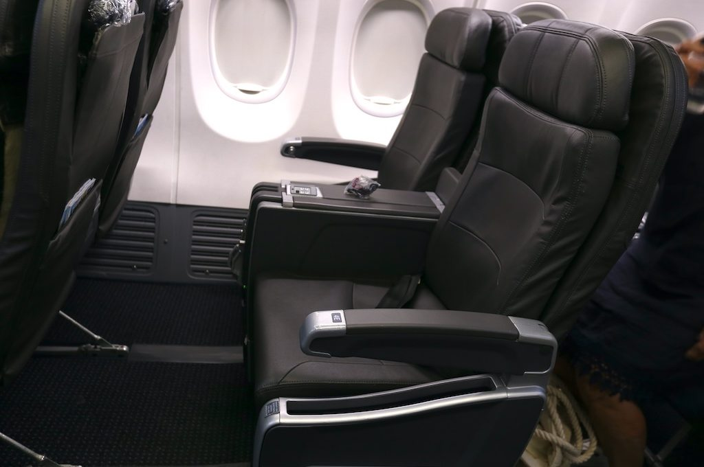 American Airlines first class seat showing legroom.