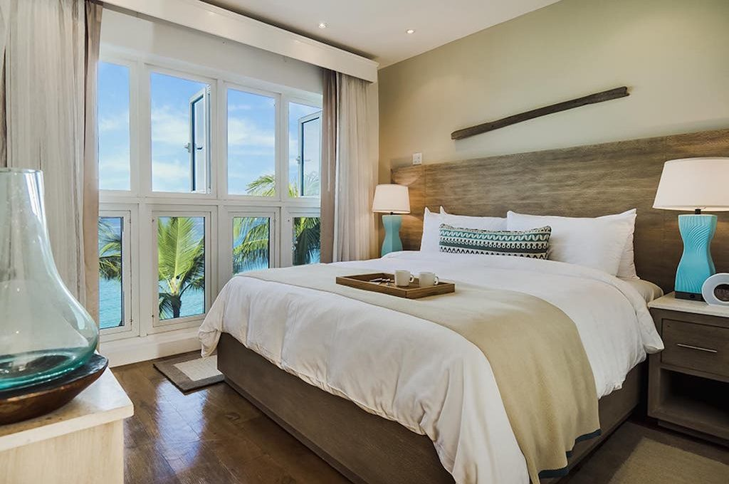 Interior gust room with ocean view at Waves Hotel and Spa, All-Inclusive.