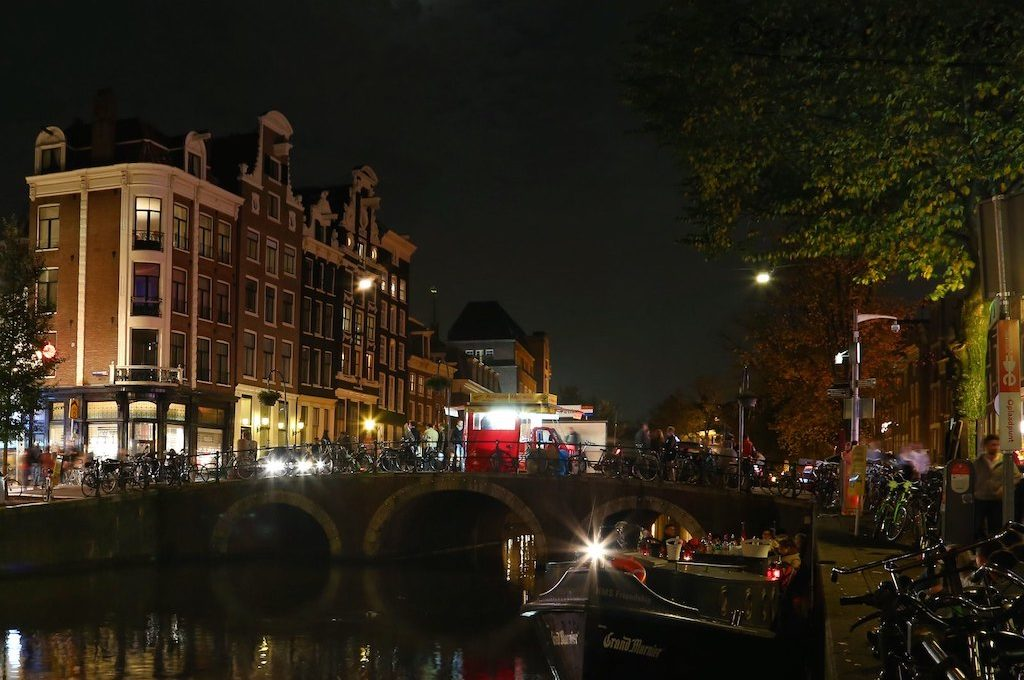 Bikes lining the canals Amsterdam at night