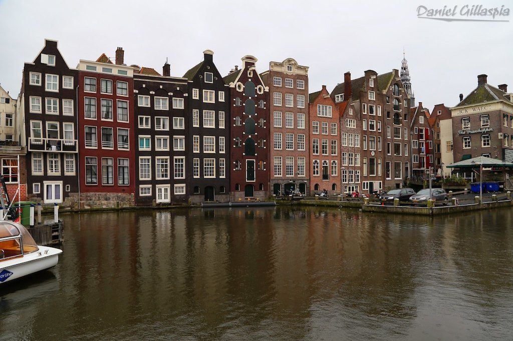 Buildings line canal in Amsterdam