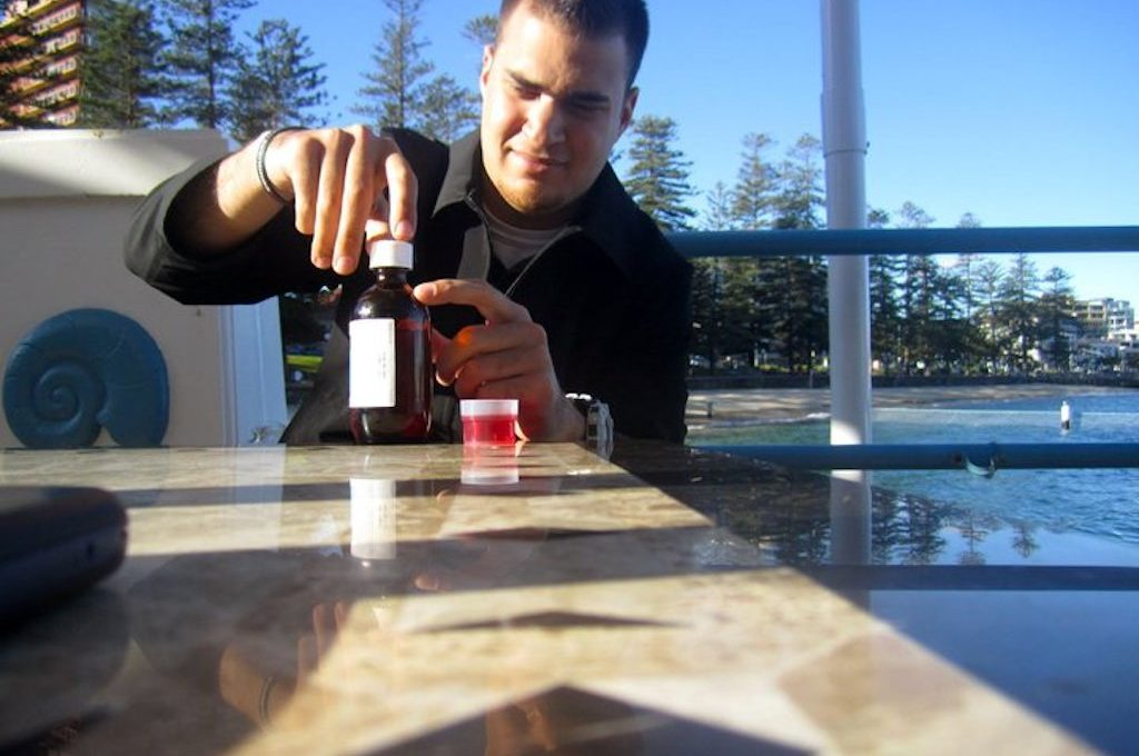 Man taking Cough Syrup