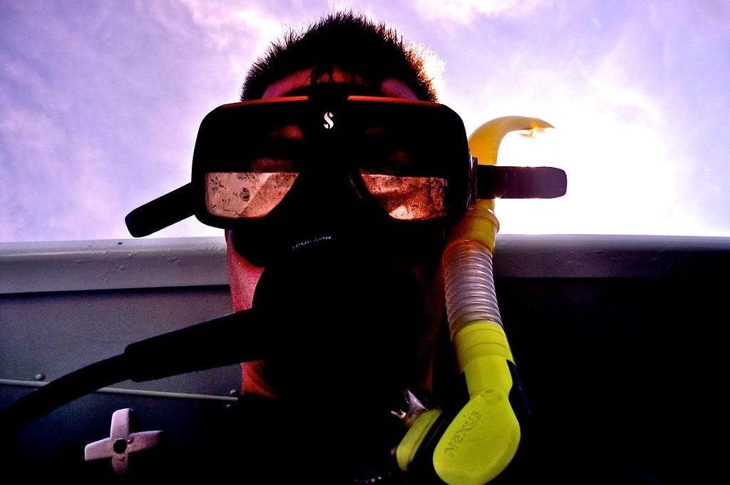 Man wearing snorkel and face mask