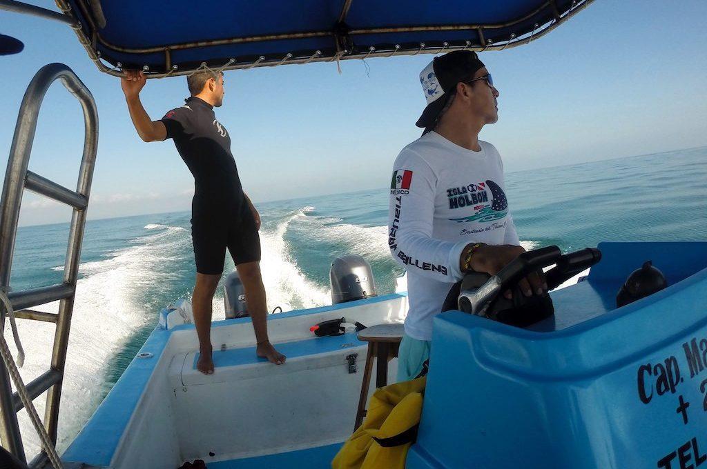 Men in moving boat