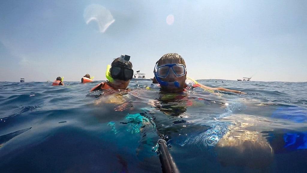 Men wearing snorkels in water