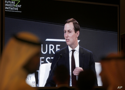 Participants watch U.S. White House senior adviser Jared Kushner on a screen during his speech at the Future Investment…