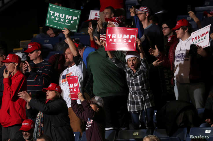 Supporters react at U.S. President Donald Trump's campaign rally in Battle Creek, Michigan, U.S., December 18, 2019. REUTERS…