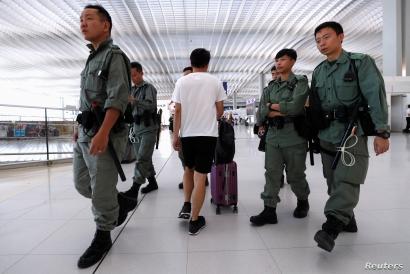 Riot police patrol inside Hong Kong International Airport in Hong Kong, China September 22, 2019. REUTERS/Jorge Silva