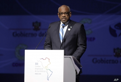 Bahamas's Prime Minister Hubert Minnis gives a speech during Americas Economics Summit in Lima, Peru, Friday, April 13, 2018. Minnis is in Lima to attend the Americas Summit. (AP Photo/Martin Mejia)