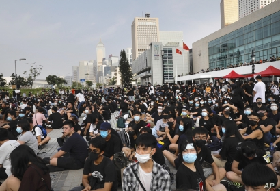 Students and others gather during a demonstration at Edinburgh Place in Hong Kong, Thursday, Aug. 22, 2019. High school students thronged a square in downtown Hong Kong Thursday to debate political reforms as residents gird for further anti…