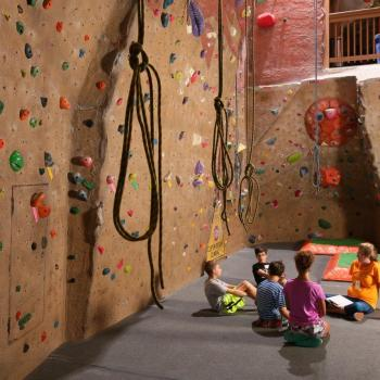 youth learning rock climbing camp clinic at upper limits downtown st. louis best indoor rock climbing gym