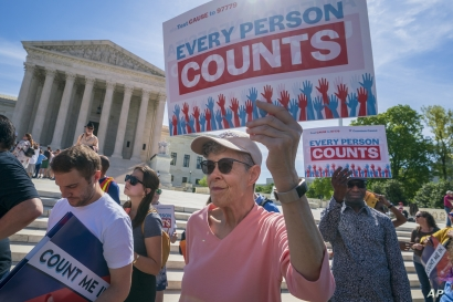 Immigration activists rally outside the Supreme Court as the justices hear arguments over the Trump administration's plan to ask about citizenship on the 2020 census, in Washington, Tuesday, April 23, 2019. Critics say the citizenship question on…