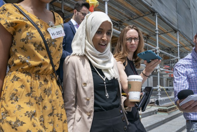 Rep. Ilhan Omar, D-Minn., a target of racist rhetoric from President Donald Trump, walks from the House to her office following votes, at the Capitol in Washington, Thursday, July 18, 2019.