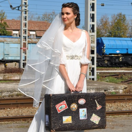 travel theme wedding photo shoot in train station