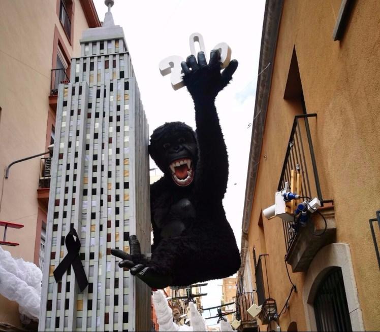 Fiesta de Gracia in Barcelona - mini representation of King Kong climbing a skyscraper