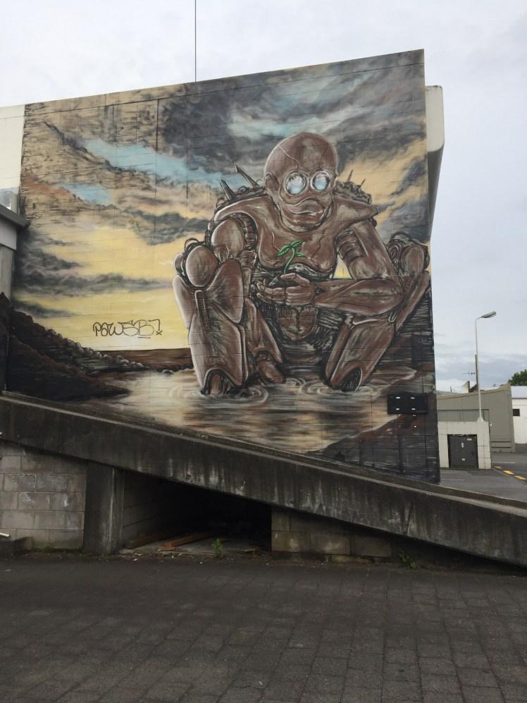 graffiato street art, Taupo, apocalyptic robot protecting plant life