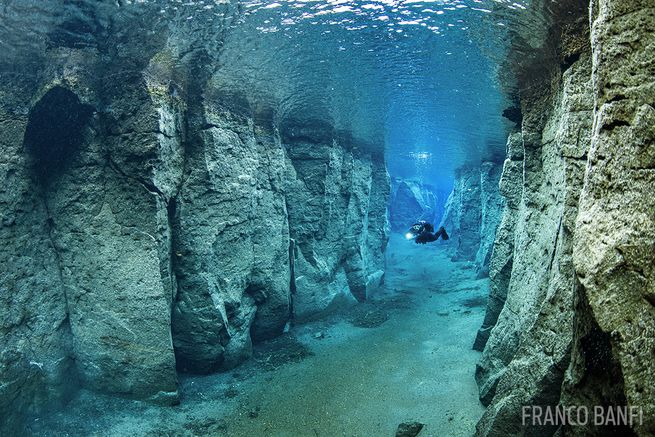 scuba diving in nesgja volcanic crater iceland blue clear waters