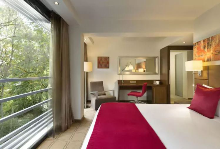 room with a forest view at dolce la hulpe hotel , Brussels