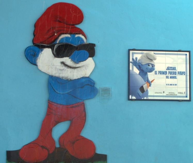 smurf painted on a blue wall in juzcar  smurf village , spain