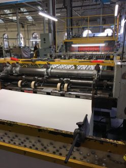Webs of paper being machine cut. A sheet like this will only have 2 deckled edges.