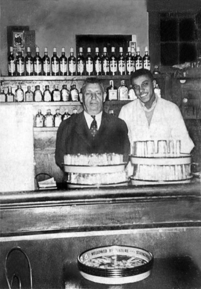 Inside_the_Washington_Hotel_with_l-r_owner_Morris_Legum_and_Bartender,_Bobby_Pointer_photograph_courtesy,_the_late_Edward__Udie__Legum_