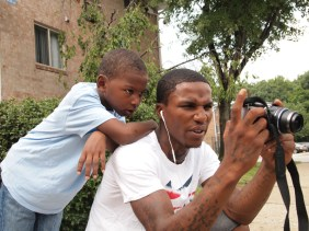 Brandon Johnson (left) shows his images he just took to a friend.