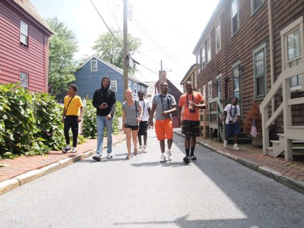 """Allison Zaucha walks up with students in Downtown Annapolis during the """"Coming Up"""" Vision Workshop."""