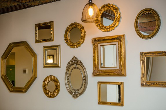A long hallway leading to the escape rooms is decorated with mirrors that Cherry salvaged from a nearby home on Conduit Street, along with mirrors from his parents' attic.