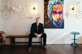 """""""People often pop into our lobby just to look at the items on our walls,"""" Cherry says of the DIY painted wall sculptures that surround a pop-art painting of Albert Einstein in his West Street entrance."""