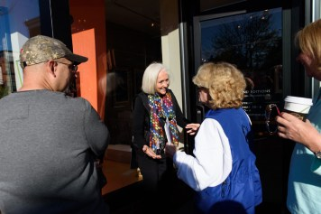 """Every year since 1997, Nancy Hammond Editions has released a limited edition poster, last year drew record crowds to her 197 West Street location as fans and collectors lined up around the block early in the morning in October. Nancy greets some of the first guests who """"camped"""" out to be first in line during the 2017 poster release. Photos by Alison Harbaugh"""