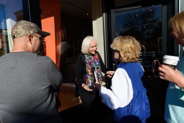 "Every year since 1997, Nancy Hammond Editions has released a limited edition poster, last year drew record crowds to her 197 West Street location as fans and collectors lined up around the block early in the morning in October. Nancy greets some of the first guests who ""camped"" out to be first in line during the 2017 poster release. Photos by Alison Harbaugh"