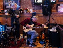 Russell Stone tunes his guitar while the OCDC band takes a break during their set at Stan and Joe's South in Edgewater, Maryland on January 13, 2018.