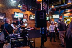 Shep Tullier (left) plays on the bass and Russell Stone plays guitar as the OCDC Band finishes their set at Stan and Joes South in Edgewater, Maryland on Saturday January 13, 2018.