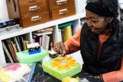 Rahel Polgreen works on one of many of her felted art pieces. The Open Eye Gallery and art program at Arundel Lodge in Edgewater provides a creative space for adults impacted by mental health and substance use disorders. Many of their works are shown around the area at various galleries and museums and sold to the community to pay the artists and cover supply expenses. Photos by Alison Harbaugh. Sugar Farm Productions
