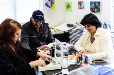 L-R: Janine Carson, Craig C. Green, & Sheryl Perez socialize and work on their respective art works during a daytime open studio at the Open Eye Gallery. The Open Eye Gallery and art program at Arundel Lodge in Edgewater provides a creative space for adults impacted by mental health and substance use disorders. Many of their works are shown around the area at various galleries and museums and sold to the community to pay the artists and cover supply expenses. Photos by Alison Harbaugh. Sugar Farm Productions