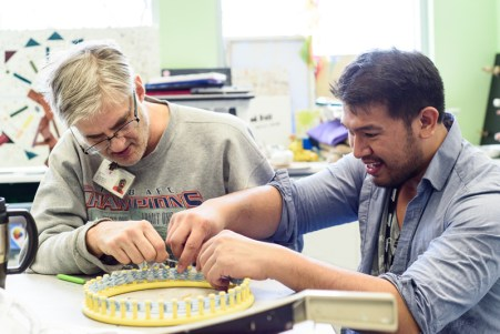 Art instructor Mark Rollamas assists Joey Turner with his weaving during an open studio at the Open Eye Gallery. The Open Eye Gallery and art program at Arundel Lodge in Edgewater provides a creative space for adults impacted by mental health and substance use disorders. Many of their works are shown around the area at various galleries and museums and sold to the community to pay the artists and cover supply expenses. Photos by Alison Harbaugh. Sugar Farm Productions