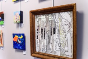 "Hallways and rooms throughout the Arundel Lodge are decorated with artworks by the Open Eye Gallery participants. Large mixed media piece ""Night Thoughts"" by Christian McCarroll. Photos by Alison Harbaugh. Sugar Farm Productions"