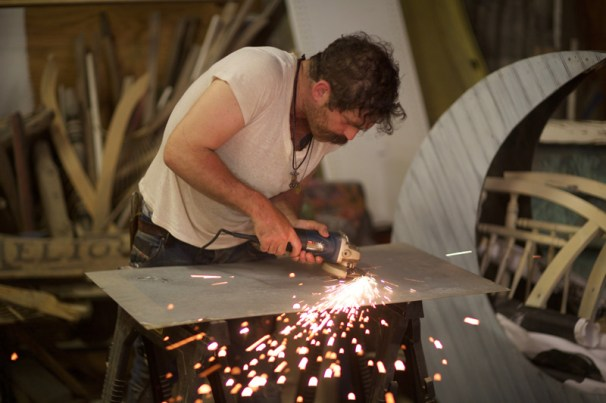 Grinding into steel for a rust piece with an angle grinder; photo by Chris Jacob_36