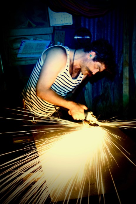 Grinding into steel for a rust piece with an angle grinder; photo by Pieter Gasperz_37