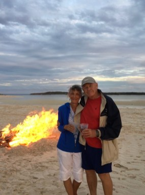 Marcia and her husband, Barry Talley, at a bonfire on Tahiti Beach, Hope Town, Bahamas. Courtesy of Marcia Talley