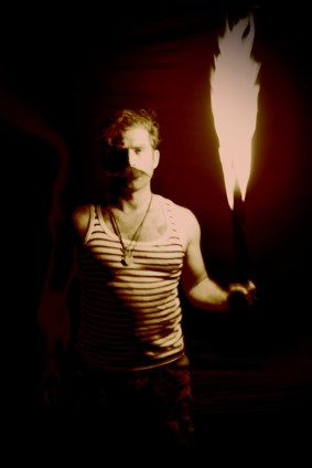 Man and his flame; photo by Pieter Gaspersz_33