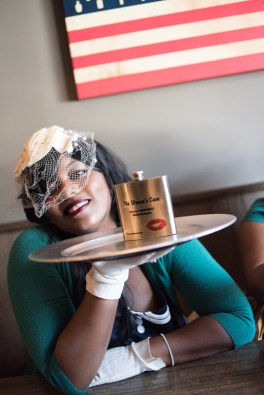 Willnona at Dry 85 in Annapolis displaying a custom flask for The Women's Cave.