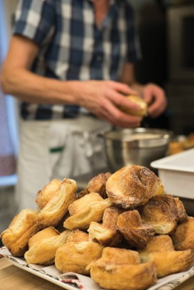 Baker and owner of Bakers and Co., Chris Simmons prepares the popular Market Buns for the morning customers. Photo by Alison Harbaugh