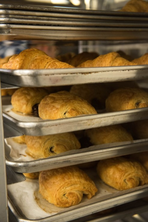 Chocolate Croissants cool on baking racks at Bakers and Co. in Eastport. Photo by Alison Harbaugh