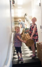 Gwen and Julia, daughter of Chris Simmons and Lucy Montgomery, owners of Bakers and Co. help out during the morning rush by bringing out a basket of fresh baked baguettes to the front of the shop. Photo by Alison Harbaugh