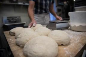 Bakers and Co. owner and baker, Chris Simmons, prepares bread dough as part of his morning routine at the bakery. Photo by Alison Harbaugh