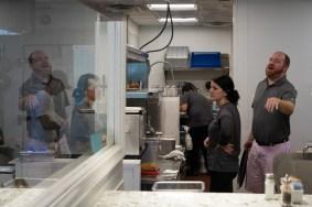 Server Jen Dollar (left) and owner Brandon Stalker wait for lunch orders at Evelyn's on September 26, 2018.