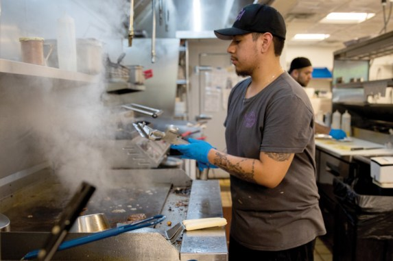 Evelyn's cook Jairo Lucrio hustles in the kitchen during the Wednesday lunch rush.